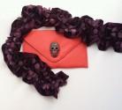 Crystal Skull Clutch Jaffa £24.99 and Elegance Plum Scarf £24.99 both from farahdboutique.com.