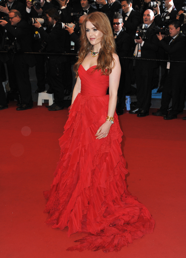 Isla Fisher in Cannes, attending the premiere of the Great Gatsby. She is wearing Oscar de la Renta and Bulgari necklace and watch.