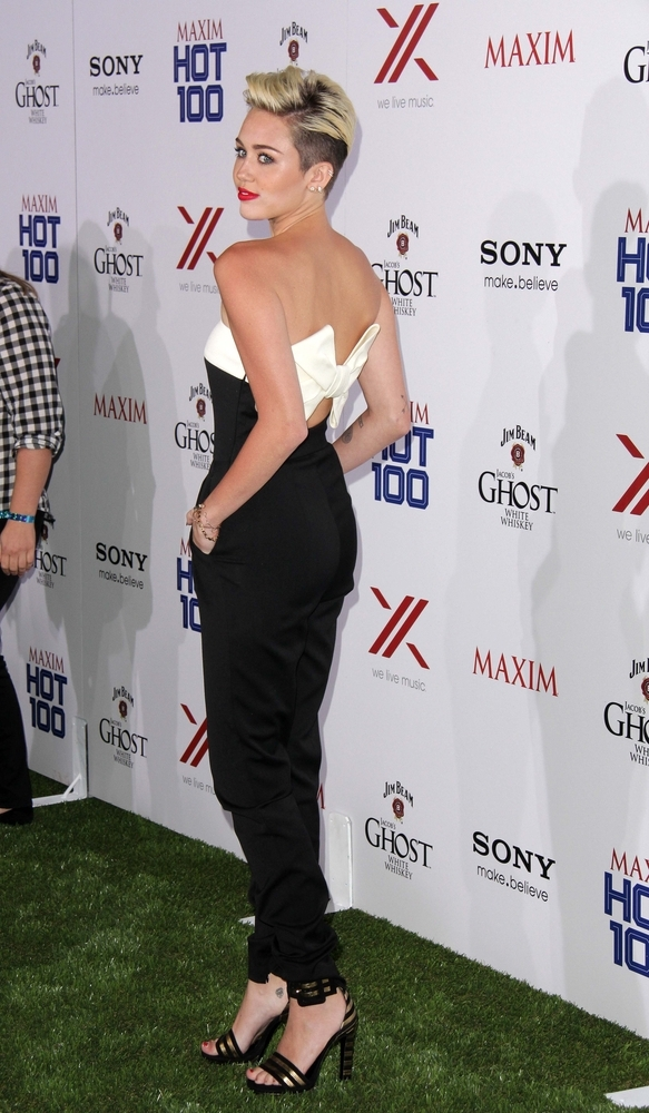 Miley Cyrus in Versace at the Maxim Hot 100 party, where she was named #1.