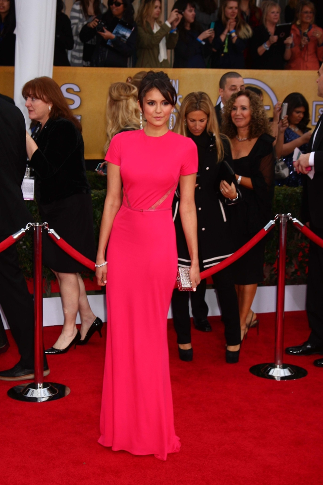 Canadian actress Nina Dobrev at the Screen Actors' Guild Awards, wearing Elie Saab and a Judith Leiber clutch.