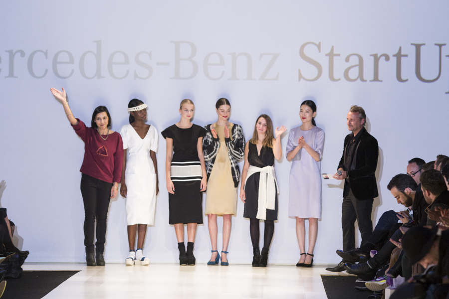 The winners of MBSU: Matiere Noire (left) and Malorie Urbanovitch (third right) pose on the catwalk.