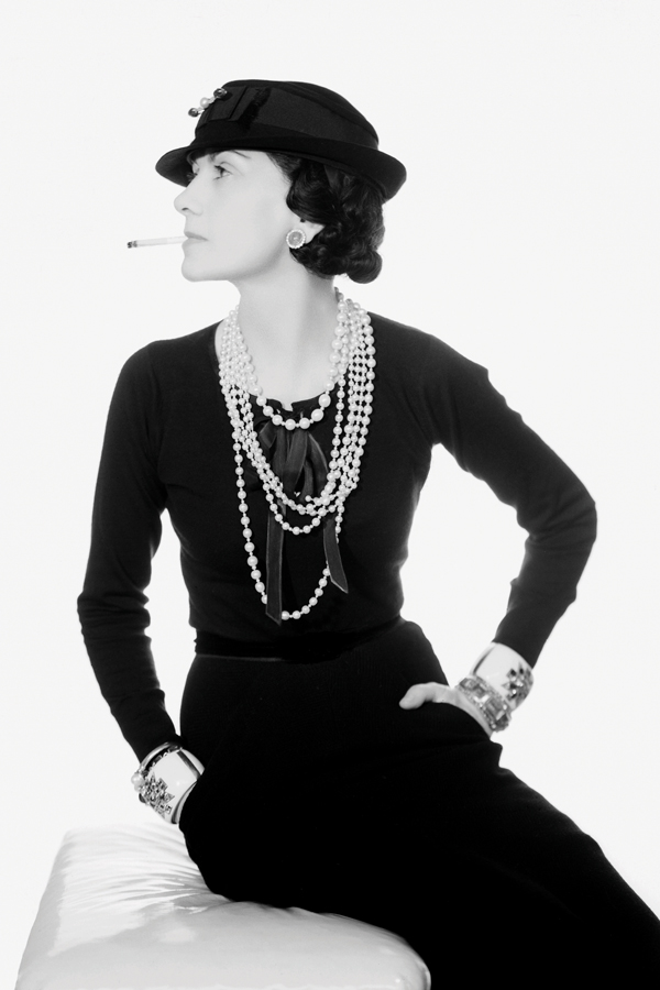 Coco Chanel with original Maltese Cross cuffs. Photo: Man Ray, 1935.
