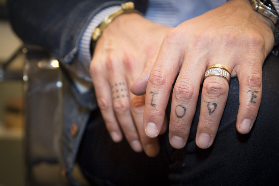 """One of Corral's most visible tattoos depicts the word """"Love."""""""