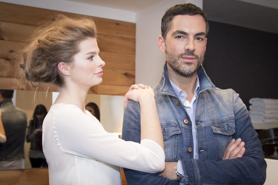 Calero with a model after doing her hair.