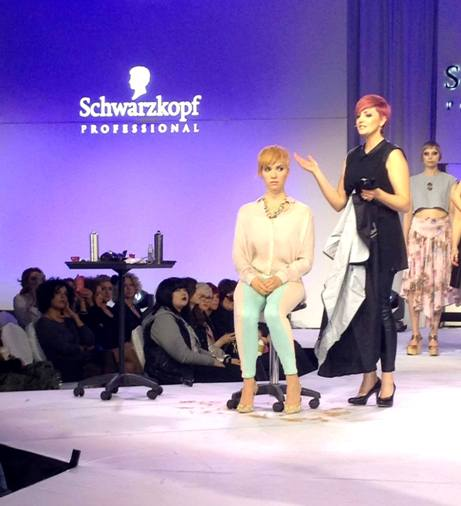 Jurenas speaks to the audience at a Schwarzkopf event.