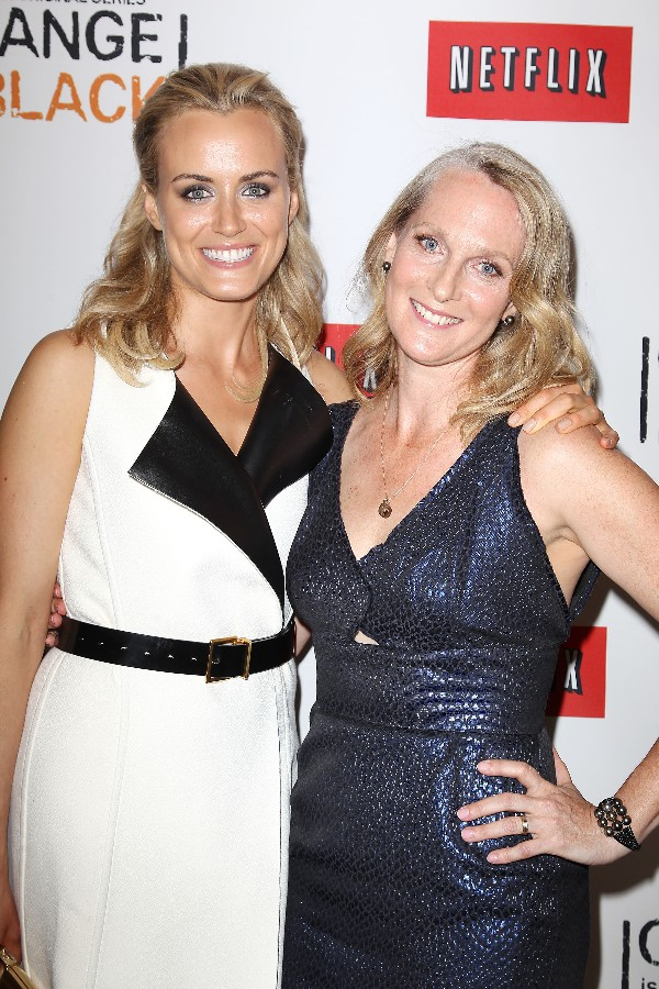 """Taylor Schilling (left) plays the role of Piper Kerman who is pictured with her at the New York Red Carpet premiere of the Netflix Original Series """"Orange is the New Black""""."""