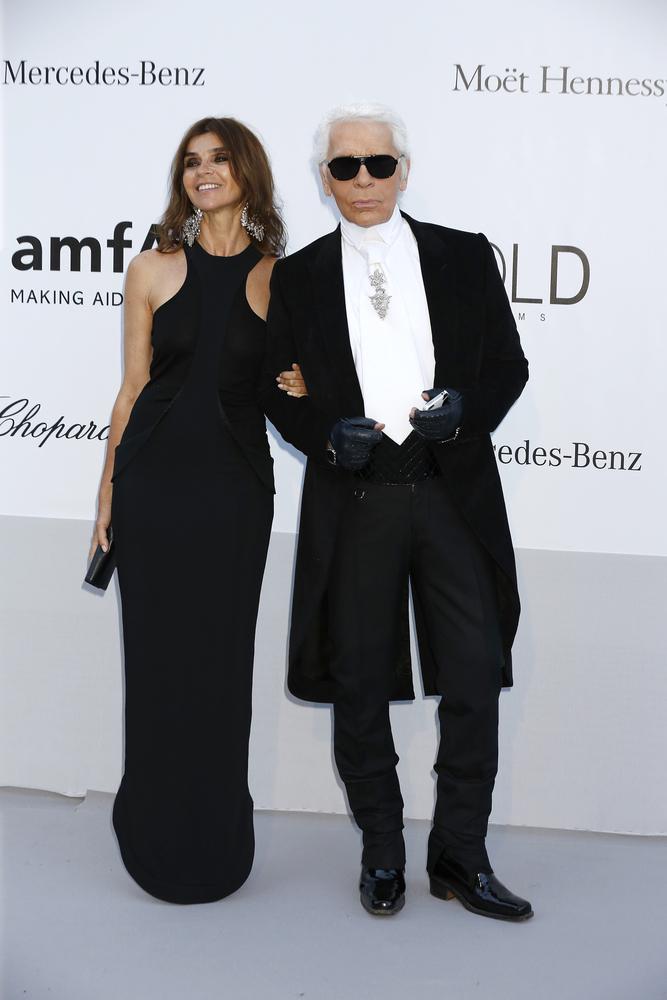 Flashback: Carine Roitfeld with Karl Lagerfeld at the 2012 amfAR's Cinema Against AIDS in France. Joe Seer / Shutterstock.com